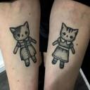 Tatouage chats en robe