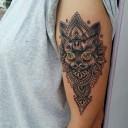 Tatouage chat sur le bras