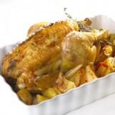 Poulet rôti au thym, lit de pommes de terre et 3 poivrons