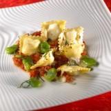 Gratin de raviolis aux fèves et pécorino